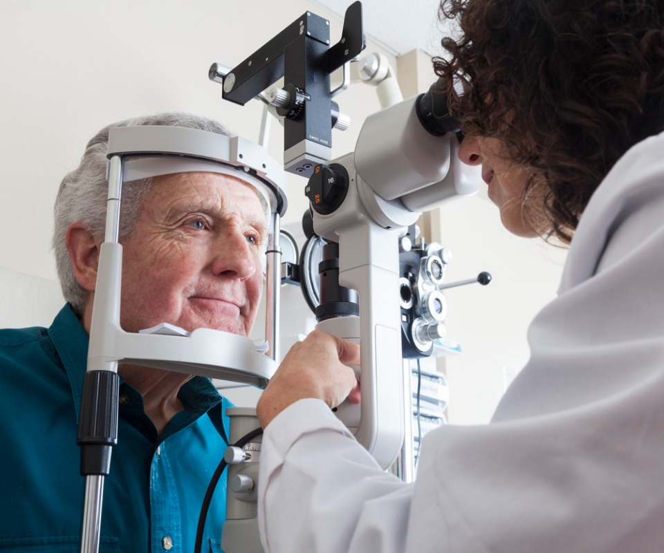 optometrist with senior patient picture